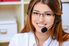 a picture of an attractive helpdesk operator wearing headset